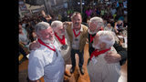 In this Saturday, July 20, 2019, photo provided by the Florida Keys News Bureau, finalists at the Hemingway Look-Alike Contest including, from left, Jon Auvil, Joe Maxey, Matt Collins, Jeffrey Peters and Dusty Rhodes gather on stage at Sloppy Joe's Bar in Key West, Fla. The competition, that attracted 142 entrants, was won by Maxey on this eighth attempt. (Andy Newman/Florida Keys News Bureau via AP)