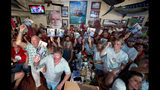 In this Saturday, July 20, 2019, photo provided by the Florida Keys News Bureau, fans of Hemingway Look-Alike Contest entrant Jon Auvil cheer for him during the 2019 competition at Sloppy Joe's Bar in Key West, Fla. The competition, that attracted 142 entrants, highlighted activities during the yearly Hemingway Days festival that honors author Ernest Hemingway who lived in Key West during the 1930s. (Andy Newman/Florida Keys News Bureau via AP)