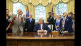 "FILE - In this Friday, July 19, 2019, file photo, President Donald Trump, center, listens to Apollo 11 astronaut Michael Collins, left, accompanied by Buzz Aldrin, Vice President Mike Pence and first lady Melania Trump, during a photo opportunity commemorating the 50th anniversary of the Apollo 11 moon landing, in the Oval Office of the White House in Washington. Collins, who circled the moon in the mother ship while Aldrin and Neil Armstrong planted a U.S. flag and gathered rocks, acknowledges that returning to the moon as a precursor to Mars is ""a valid plan."" ""But I don't have to agree with it,"" Collins said in an interview. ""I would take what I call the John F. Kennedy approach and I'd say if you want to go to Mars, you say you want to go to Mars and you go."" (AP Photo/Alex Brandon, File)"