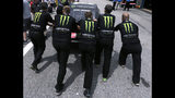 Kurt Busch's team pushes his car towards inspection prior to a NASCAR Cup Series auto race practice at New Hampshire Motor Speedway in Loudon, N.H., Saturday, July 20, 2019. (AP Photo/Charles Krupa)