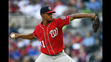Washington Nationals' Joe Ross pitches against the Atlanta Braves during the first inning of a baseball game Sunday, July 21, 2019, in Atlanta. (AP Photo/John Amis)