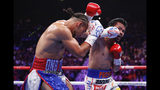 Manny Pacquiao, right, and Keith Thurman exchange punches in the second round during a welterweight title fight Saturday, July 20, 2019, in Las Vegas. (AP Photo/John Locher)