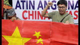 "Protesters display a mock Chinese flag as they prepare to march closer to the Philippine Congress to protest the 4th State of the Nation (SONA) address by President Rodrigo Duterte Monday, July 22, 2019 in suburban Quezon city, northeast of Manila, Philippines. Duterte is facing criticisms about his alleged closeness with China as well as the thousands of killings in his so-called war on drugs. The complete sign reads: ""Philippines is ours, China out!"" (AP Photo/Bullit Marquez)"