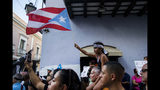 Demonstrators protest against Gov. Ricardo Rossello in San Juan, Puerto Rico, Sunday, July 21, 2019. Puerto Rico's embattled governor says he will not seek re-election but will not resign as the island's leader, though he will step down as head of his pro-statehood party. (AP Photo/Dennis M. Rivera Pichardo)