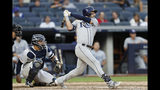 Tampa Bay Rays' Kevin Kiermaier hits a double during the ninth inning of the first game of a baseball doubleheader against the New York Yankees, Thursday, July 18, 2019, in New York. Yankees catcher Gary Sanchez watches at left. (AP Photo/Kathy Willens)
