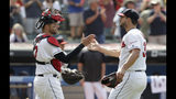 Cleveland Indians relief pitcher Brad Hand, right, and Kevin Plawecki celebrate after they defeated the Kansas City Royals in a baseball game, Sunday, July 21, 2019, in Cleveland. (AP Photo/Tony Dejak)