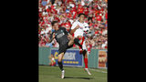 Liverpool's Harry Wilson, left, and Sevilla's Reguilon Rodriguez Sergio vie for the ball during the first half of a friendly soccer match at Fenway Park, Sunday, July 21, 2019, in Boston. (AP Photo/Mary Schwalm)