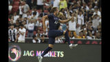 Tottenham's Harry Kane celebrates after scoring a goal during the International Champions Cup soccer match between Juventus and Tottenham Hotspur in Singapore, Sunday, July 21, 2019. (AP Photo/Danial Hakim)
