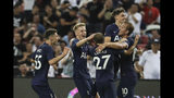 Tottenham's Harry Kane celebrates with his teammates after scoring a goal during the International Champions Cup soccer match between Juventus and Tottenham Hotspur in Singapore, Sunday, July 21, 2019. (AP Photo/Danial Hakim)