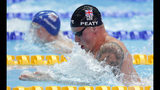 Britain's Adam Peaty swims in his heat of the men's 100m breaststroke at the World Swimming Championships in Gwangju, South Korea, Sunday, July 21, 2019. (AP Photo/Lee Jin-man)