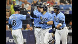 From left to right, Tampa Bay Rays' Joey Wendle, Avisail Garcia, Travis d'Arnaud and Yandy Diaz celebrate d'Arnaud's grand slam off Chicago White Sox starter Dylan Cease during the second inning of a baseball game Sunday, July 21, 2019, in St. Petersburg, Fla. (AP Photo/Steve Nesius)