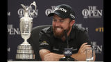 Ireland's Shane Lowry smiles as he sits next to the Claret Jug trophy while he attends a press conference after he won the British Open Golf Championships at Royal Portrush in Northern Ireland, Sunday, July 21, 2019.(AP Photo/Peter Morrison)