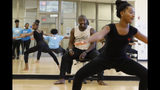 In this Friday, June 28, 2019 photo, Jelani Akil Jones, an Atlanta Ballet modern dance instructor, coaches a group of campers at the Martha Ellen Stilwell School of the Arts in Jonesboro, Ga. as they perfect a routine for their final performance. (AP Photo/Andrea Smith)