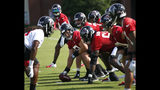 Atlanta Falcons center Alex Mack (51), second from left, prepares to run a play during their NFL training camp football practice Monday, July 22, 2019, in Flowery Branch, Ga.(AP Photo/John Bazemore)