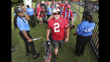 Atlanta Falcons fan John Bennett, of Gainesville, goes through security at the Atlanta Falcons NFL football training camp in Flowery Branch, Ga., Monday, July 22, 2019. (Curtis Compton/Atlanta Journal-Constitution via AP)