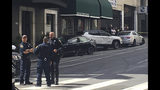 This photo taken Sunday, July 21, 2019, and provided by KGO-TV shows the scene after a woman was arrested after running a red light in a rented Tesla in San Francisco and causing a crash that killed a tourist and left his wife critically injured. Officers were investigating whether the Tesla, which was rented through the peer-to-peer car rental service Get Around, was operating on self-driving mode, police said in a statement Monday, July 22, 2019. (Kate Larsen/KGO-TV via AP)