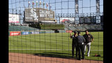 Security personnel at Guaranteed Rate Field are viewed through the newly extended protective netting along left field before a baseball game between the Miami Marlins and the Chicago White Sox, Monday, July 22, 2019, in Chicago. (AP Photo/Charles Rex Arbogast)