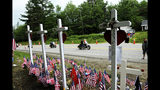 FILE - In this July 6, 2019, file photo, motorcyclists participate in a ride in Randolph, N.H., to remember seven bikers killed there in a collision with a pickup truck in June. State transportation officials in Massachusetts are expected to be questioned during a legislative oversight hearing on Monday, July 22, 2019, in Boston, about the Registry of Motor Vehicles' failure to suspend the commercial license of the truck driver charged in the crash that killed the seven motorcyclists in New Hampshire. (Paul Hayes/Caledonian-Record via AP, File)
