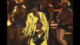 """FILE - This June 23, 2019 file photo shows Lil Nas X performing """"Old Town Road"""" at the BET Awards in Los Angeles. The rapper has taken his horse to the old town road and ridden it to the top of the Billboard charts for 16 weeks, tying a record set by Mariah Carey and Luis Fonsi. (Photo by Chris Pizzello/Invision/AP, File)"""