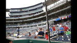 New netting separates the infield from lower bowl seating before a postponed baseball game between the Colorado Rockies and the Washington Nationals, Monday, July 22, 2019, in Washington. (AP Photo/Patrick Semansky)