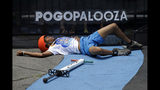 Antonie Smith, 16, of Memphis, Tenn., holds his side after taking a spill during his performance during Pogopalooza, The World Championships of Pogo in Wilkinsburg, Pa., Saturday, July 20, 2019. Smith was tend by medics and returned to the competition. The two day competition ends with the finals on Sunday. (AP Photo/Gene J. Puskar)