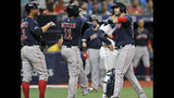 Boston Red Sox's Xanader Bogaerts, left, and Rafael Devers (11) celebrate with J.D. Martinez, right, after Martinez hit a three-run home run off Tampa Bay Rays starter Jalen Beeks during the third inning of a baseball game Monday, July 22, 2019, in St. Petersburg, Fla. (AP Photo/Steve Nesius)