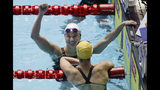 Canada's Margaret MacNeil reacts after winning the women's 100m butterfly final at the World Swimming Championships in Gwangju, South Korea, Monday, July 22, 2019. (AP Photo/Mark Schiefelbein)
