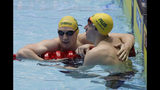 Australia's Mack Horton, left, is congratulated by teammate Jack McLoughlin after his second place finish in the men's 400m freestyle final at the World Swimming Championships in Gwangju, South Korea, Sunday, July 21, 2019. (AP Photo/Mark Schiefelbein)