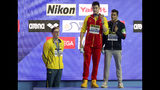 China's Sun Yang, centre, holds up his gold medal as silver medalist Australia's Mack Horton, left, stands away from the podium and bronze medalist Italy's Gabriele Detti after the men's 400m freestyle final at the World Swimming Championships in Gwangju, South Korea, Sunday, July 21, 2019. (AP Photo/Mark Schiefelbein)