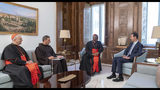 In this photo released on the official Facebook page of the Syrian Presidency, Syrian President Bashar Assad, right, meets Cardinal Peter Turkson, second right, in Damascus, Syria, Monday, July 22, 2019. Syrian state media says Pope Francis sent a message to President Bashar Assad expressing his support for the restoration of stability in Syria and an end to the suffering of its people. Assad's office released a statement saying that the message was delivered Monday by Cardinal Peter Turkson. (Syrian Presidency via Facebook)