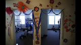 In this Tuesday, July 9, 2019, photo, decorations cover the walls of the rooms of immigrants at the U.S. government's newest holding center for migrant children in Carrizo Springs, Texas. Long trailers once used to house oil workers in two-bedroom suites have been turned into 12-person dorms, with two pairs of bunk beds in each bedroom and the living room. (AP Photo/Eric Gay)