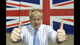 FILE - In this Thursday, June 27, 2019 file photo Conservative leadership candidate Boris Johnson gives the thumbs at the Wight Shipyard Company at Venture Quay during a visit to the Isle of Wight, England. (Dominic Lipinski/Pool Photo via AP, File)