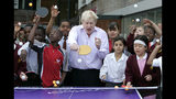 FILE - In this Friday, June 25, 2010 file photo, Mayor of London Boris Johnson, center, poses for photographers as he plays a game of table tennis with pupils in London. (AP Photo/Akira Suemori, File)