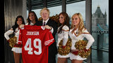 FILE - In this Tuesday, Oct., 26, 2010 file photo Boris Johnson, then Mayor of London center, and four of the 49ers cheerleaders Deanna Ortega, left, Morgan McLeod, Alexis Kofoed and Lauren Riccaboni, right, pose for the media as the Mayor holds a team shirt with his name on at City Hall in London. (AP Photo/Alastair Grant)