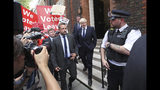Conservative Party leadership contender Boris Johnson, centre right, leaves his office in Westminster area of London, Monday July 22, 2019. Voting closes Monday in the ballot to elect Britain's next prime minister, from the two contenders Jeremy Hunt and Boris Johnson, as critics of likely winner Boris Johnson condemned his vow to take Britain out of the European Union with or without a Brexit deal.(Yui Mok/PA via AP)
