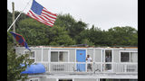 A steel flag pole bows to the wind framing the second floor of the Cape Sands Inn where a tornado touched down ripping the second floor on the structure, Tuesday, July 23, 2019, in West Yarmouth, Mass. The National Weather Service said radar showed that a tornado struck Yarmouth just after noon on Tuesday. (Steve Heaslip/The Cape Cod Times via AP)