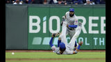 Chicago Cubs right fielder Jason Heyward, rear, chases the ball next to fallen center fielder Albert Almora Jr. on a single hit by San Francisco Giants' Brandon Belt during the fifth inning of a baseball game in San Francisco, Monday, July 22, 2019. (AP Photo/Jeff Chiu)
