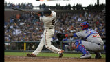 San Francisco Giants' Mike Yastrzemski, left, hits an RBI-single in front of Chicago Cubs catcher Martin Maldonado during the fifth inning of a baseball game in San Francisco, Monday, July 22, 2019. (AP Photo/Jeff Chiu)