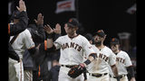 San Francisco Giants' Austin Slater, center, celebrates with teammates after the Giants defeated the Chicago Cubs in a baseball game in San Francisco, Monday, July 22, 2019. (AP Photo/Jeff Chiu)