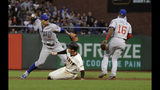 Chicago Cubs shortstop Javier Baez, left, throws to first base after forcing out San Francisco Giants' Mike Yastrzemski, center, at second base on a double play hit into by Pablo Sandoval during the fifth inning of a baseball game in San Francisco, Monday, July 22, 2019. Cubs second baseman Robel Garcia (16) looks on. (AP Photo/Jeff Chiu)