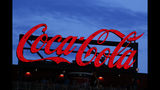 In this July 20, 2019, photo a Coca-Cola billboard is shown over left field at SunTrust Park during a baseball game between the Washington Nationals and Atlanta Braves in Atlanta. The Coca-Cola Co. reports earnings Tuesday, July 23. (AP Photo/John Bazemore)