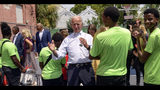 Democratic presidential candidate former Vice President Joe Biden speaks to kids as he tours the Youth Empowerment Project that targets at risk youth and young people with the drum line in New Orleans, Tuesday, July 23, 2019. (AP Photo/Matthew Hinton)