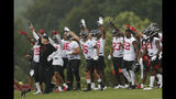 Atlanta Falcons head coach Dan Quinn, left, and the defense react on the sideline during their NFL training camp football practice Tuesday, July 23, 2019, in Flowery Branch, Ga.(AP Photo/John Bazemore)