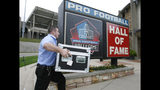 FILE - In this Sept. 28, 2018, file photo, the Vince Lombardi Trophy, produced by Tiffany & Co., is delivered to the Pro Football Hall of Fame by a representative of Brinks, who did not want to be identified, in Canton, Ohio. Approximately 250,000 visitors tour the hall annually, a group that includes rookies from the Cleveland Browns and Philadelphia Eagles this year alone. Small groups can go behind the scenes touring the Ralph Wilson, Jr. Pro Football Research & Preservation Center with an archivist. (Scott Heckel/The Canton Repository via AP, File)