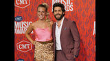 FILE - This June 5, 2019 file photo shows Lauren Akins, left, and Thomas Rhett at the CMT Music Awards in Nashville, Tenn. Rhett announced on social media that his wife is pregnant with another girl. (AP Photo/Sanford Myers, File)