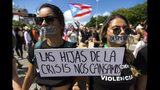 "Demonstrators with their mouths covered with a tape and a sign that reads in Spanish ""The daughters of the crisis got tired"" during a march on Las Americas highway demanding the resignation of governor Ricardo Rossello, in San Juan, Puerto Rico, Monday, July 22, 2019. Protesters are demanding Rossello step down for his involvement in a private chat in which he used profanities to describe an ex-New York City councilwoman and a federal control board overseeing the island's finance. (AP Photo / Dennis M. Rivera Pichardo)"