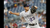 Colorado Rockies starting pitcher Peter Lambert throws to the Washington Nationals in the first inning of a baseball game, Tuesday, July 23, 2019, in Washington. (AP Photo/Patrick Semansky)