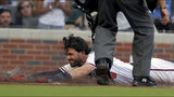 Atlanta Braves Dansby Swanson slides safely into home plate on a hit against the Kansas City Royals during the first inning of a baseball game Tuesday, July 23, 2019, in Atlanta. (AP Photo/Tami Chappell)