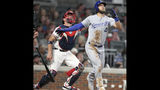 Kansas City Royals batter Alex Gordon watches his solo home run as Atlanta Braves catcher Tyler Flowers, left, looks on during the sixth inning of a baseball game Tuesday, July 23, 2019, in Atlanta. (AP Photo/Tami Chappell)