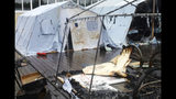 In this photo provided by Russian Emergency Situations Ministry for the Khabarovsk Region Press Service, a tent camp is seen after a fire near Solnechny village, Khabarovsk Region, Russia, Thursday, July 23, 2019. Russian authorities say three children have died in a fire at the tent camp in a ski area in the Khabarovsk region about 6,000 kilometers (3,700 miles) east of Moscow, that housed some 189 people at the time of the fire, news reports said. (Ministry of Emergency Situations for Khabarovsk Region Press Service via AP)